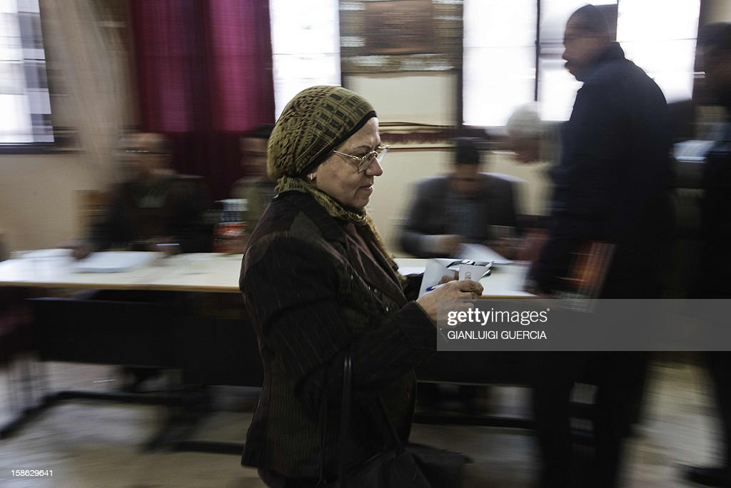 An Egyptian woman walks towards a ballot box to cast her vote during the second round of a referendum on a new draft constitution in Giza, south of Cairo, on December 22, 2012. Egyptians are voting in the final round of a referendum on a new constitution championed by President Mohamed Morsi and his Islamist allies against fierce protests from the secular-leaning opposition.