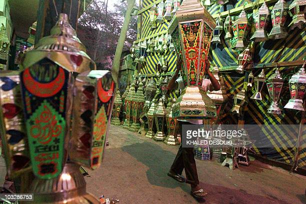 An Egyptian worker carries a handmade lantern used during the Muslim holy fasting month of Ramadan at a workshop in downtown Cairo on August 7 2010...