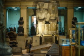 An Egyptian worker cleans some of the archeological pieces inside the Egyptian Museum on February 16 2011 Looters broke into the museum in Cairo's...