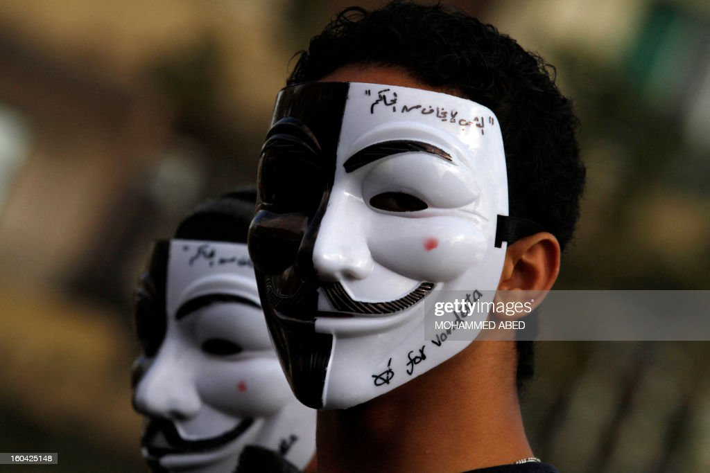 An Egyptian youth wears a Guy Fawkes mask, trademark of the anonymous movement and based on a character in the film V for Vendetta, with writing on it reading in Arabic: 'The people are not afraid of the ruler' during a demonstration in Cairo's Tahrir square on January 31, 2013. Rival factions in Egypt condemned the violence which has killed dozens in a week of unrest and pledged support for a national dialogue to resolve the political crisis gripping the country.