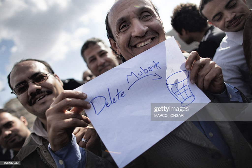 An Egytpian demonstrator shows a home drawn sign as he and others protest in Tahrir Square in Cairo on January 31, 2011, on the seventh day of mass protests calling for the removal of Egypt's President Hosni Mubarak.