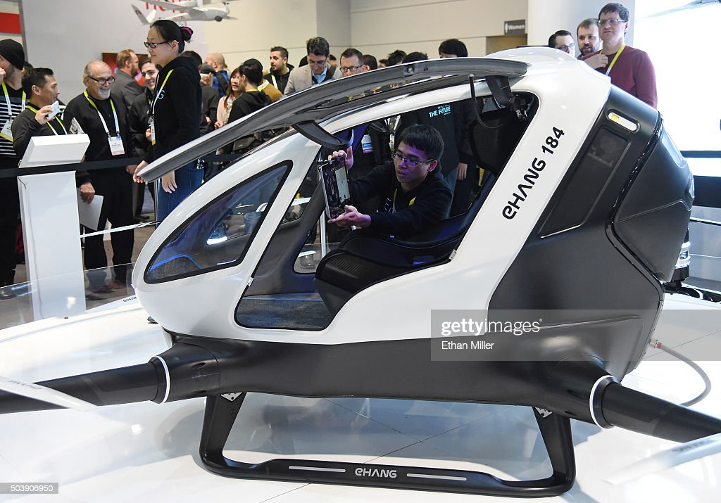 An EHang 184 autonomous-flight drone that can fly a person is displayed at CES 2016 at the Las Vegas Convention Center on January 7, 2016 in Las Vegas, Nevada. The 18-foot-long, 440-pound drone has four arms and eight propellers and can fly up to 63 mph for 23 minutes and go about 20 miles. It can carry one passenger who does not need to pilot the drone. Once a destination is entered, only a take off or land button needs to be pushed to travel. The drone takes off and lands vertically eliminating the need for a runway. CES, the world's largest annual consumer technology trade show, runs through January 9 and features 3,600 exhibitors showing off their latest products and services to more than 150,000 attendees.