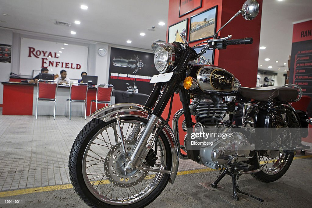 An Eicher Motors Ltd. Royal Enfield Classic Chrome motorcycle stands on display at the company's Royal Enfield flagship dealership in Gurgaon, India, on Monday, May 20, 2013. The Indian maker of Royal Enfield, the World War II-era British motorcycle owned by stars including Brad Pitt, plans to export the vehicles to Southeast Asia and Latin America as it builds on record sales at home. Photographer: Prashanth Vishwanathan/Bloomberg via Getty Images