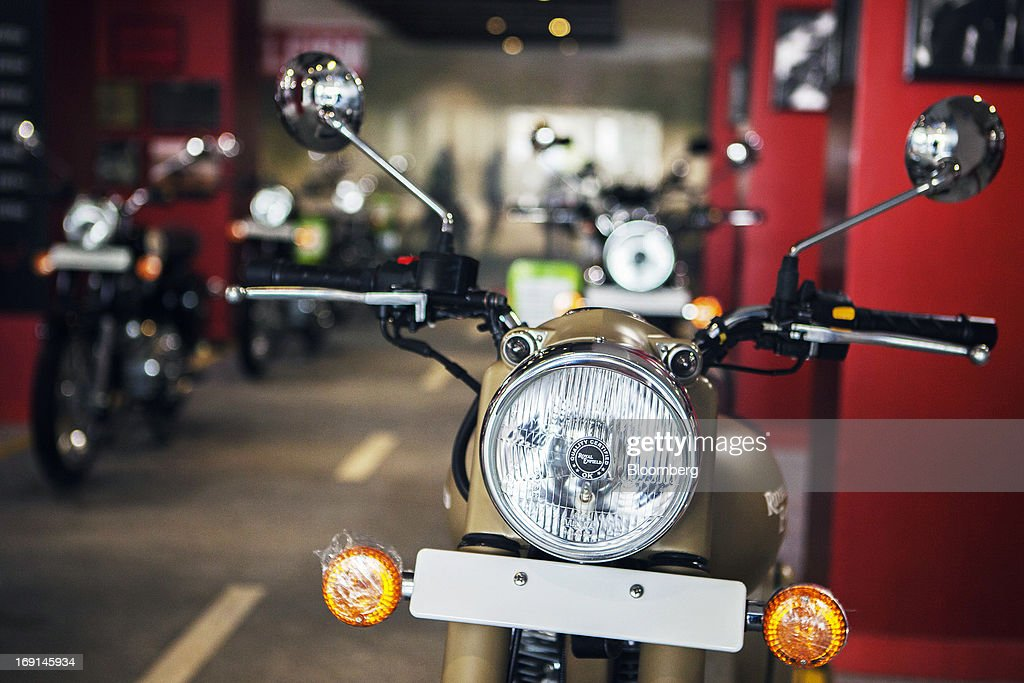An Eicher Motors Ltd. Royal Enfield Desert Storm motorcycle stands on display at the company's Royal Enfield flagship dealership in Gurgaon, India, on Monday, May 20, 2013. The Indian maker of Royal Enfield, the World War II-era British motorcycle owned by stars including Brad Pitt, plans to export the vehicles to Southeast Asia and Latin America as it builds on record sales at home. Photographer: Prashanth Vishwanathan/Bloomberg via Getty Images