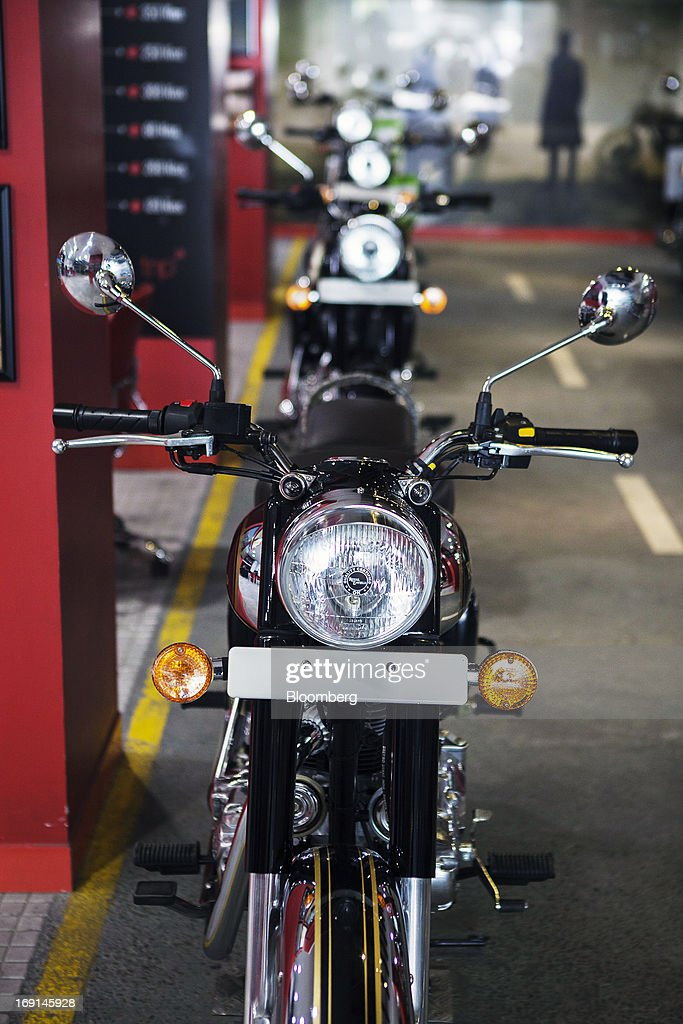 An Eicher Motors Ltd. Royal Enfield motorcycle stands on display at the company's Royal Enfield flagship dealershiip in Gurgaon, India, on May 20, 2013. The Indian maker of Royal Enfield, the World War II-era British motorcycle owned by stars including Brad Pitt, plans to export the vehicles to Southeast Asia and Latin America as it builds on record sales at home. Photographer: Prashanth Vishwanathan/Bloomberg via Getty Images
