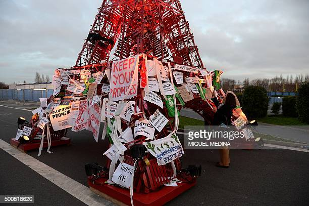 An Eiffel Tower made of bistro chairs is seen covered in messages related to climate change at the COP21 the United Nations conference on climate...