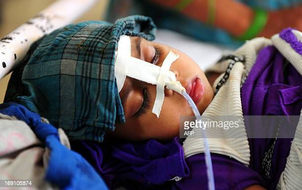 An eight month old Indian baby suffering from diarrhoea lies on a bed at a Government children's hospital in Allahabad on May 20 2013 There has been...