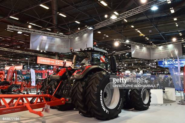 An eightwheel Massey Ferguson tractor is displayed during the SIMA Paris International agribusiness show at the Parc des Expositions Paris Nord in...