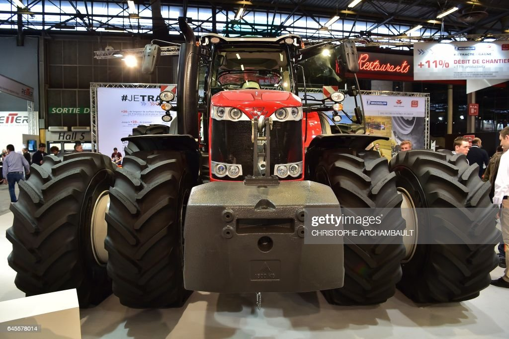 An eight-wheel Massey Ferguson tractor is displayed during the SIMA, Paris International agribusiness show at the Parc des Expositions Paris Nord in Villepinte on February 26, 2017. / AFP / CHRISTOPHE