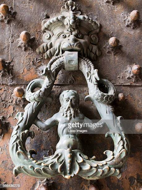 An elaborate door and knocker to the Palazzo Ducale in Genoa