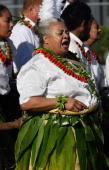 An elder wearing a fa seed necklace calls out to King George Tupou V of Tonga as she arrives for the taumafa kava ritual and coronation ceremony in...