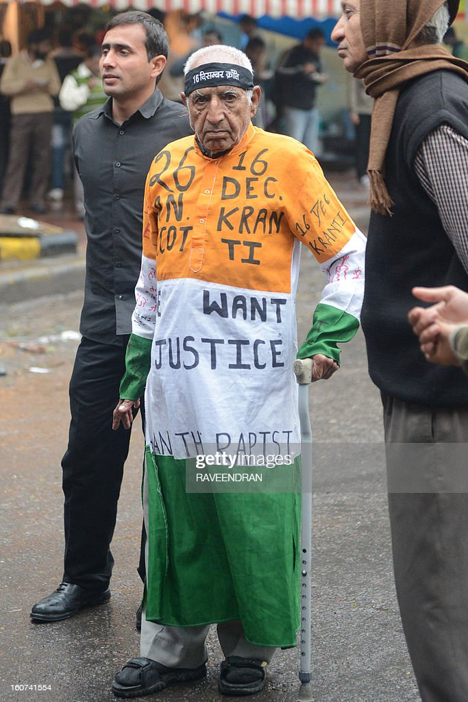 An elderly activist decked in the colours of the Indian flag participates in a protest against the gang rape and murder of a student in New Delhi on February 5, 2013. The companion of an Indian medical student who died after being gang-raped on a bus in New Delhi was to begin giving evidence on Tuesday in the trial of five adults accused of her murder, his father said.