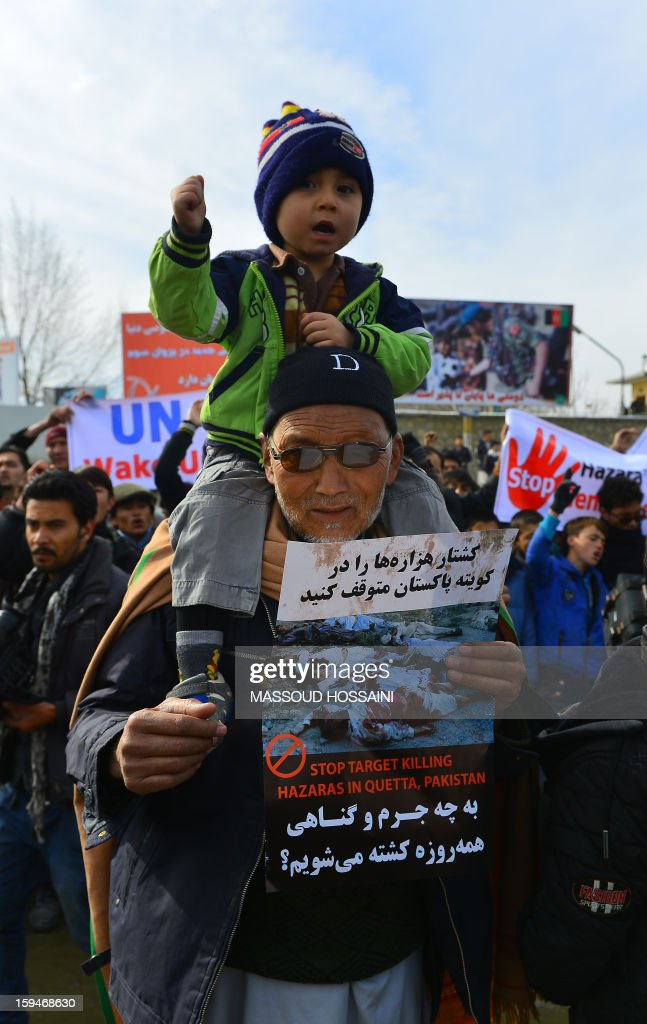 An elderly Afghan Hazara man holds a child as he shout slogans to condemn the killing of Hazaras in Quetta city of Pakistan during a demonstration in Kabul on January 14, 2013. Several hundreds of Hazara men and women participated in a demonstration to condemn the twin suicide attacks in Pakistan which killed 92 people in the southwestern city of Quetta on January 10. AFP PHOTO / Massoud HOSSAINI