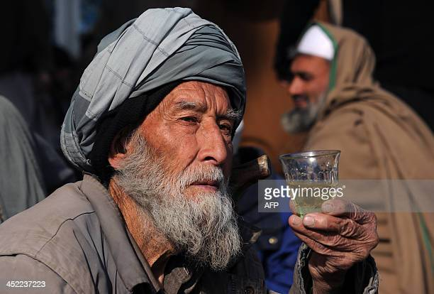 An elderly Afghan man drinks tea at a tea house in Kabul on November 27 2013 The wartorn country still faces poverty unemployment and lack of...