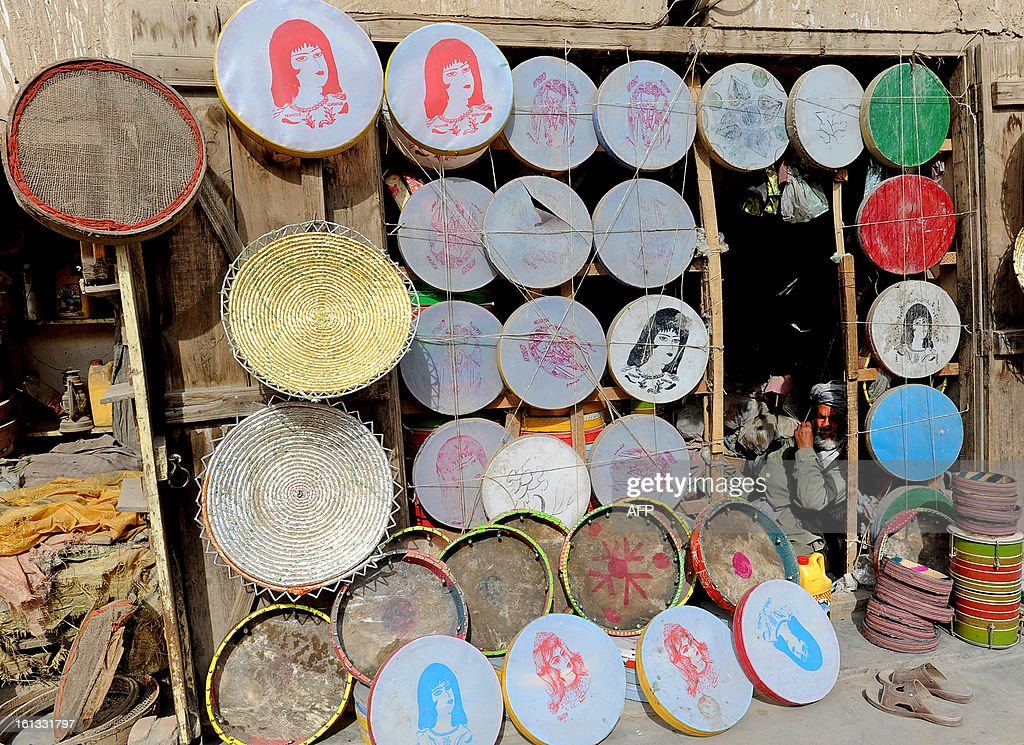 An elderly Afghan man sells traditional drums in Kandahar on February 9, 2013. Over a third of Afghans are living in abject poverty, as those in power are more concerned about addressing their vested interests rather than the basic needs of the population, a UN report said.