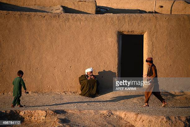 An elderly Afghan villager sits outside a hut on the outskirts of Herat on November 26 2015 AFP PHOTO / Aref Karimi / AFP / Aref Karimi