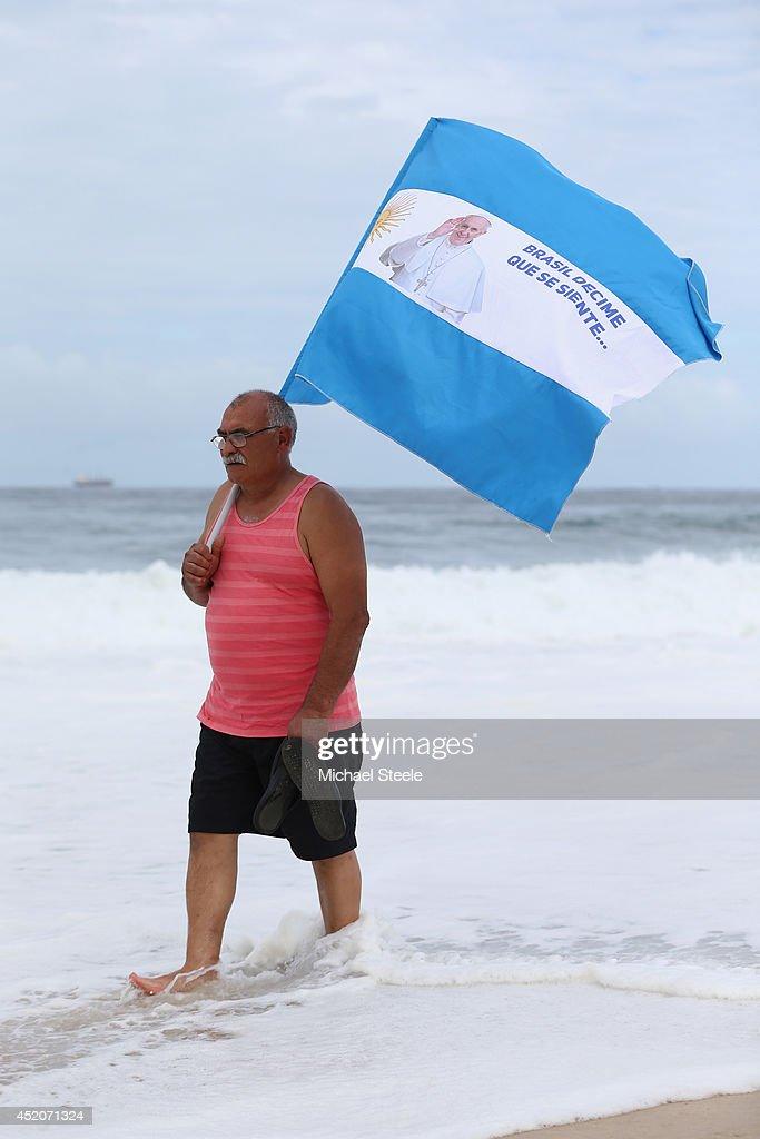 An elderly Argentina fan strolls on Copacabana Beach ahead of the 2014 FIFA World Cup Brazil Final match on July 12, 2014 in Rio de Janeiro, Brazil.