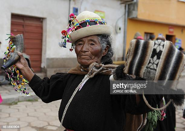 An elderly Aymara native takes part in a parade held after a ritual ceremony for reelected Bolivian President Evo Morales along the streets of the...