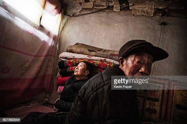 An elderly Chinese couple who did not give their name rest in their aging farmhouse on January 23 2016 in a village of Chongli district Hebei...