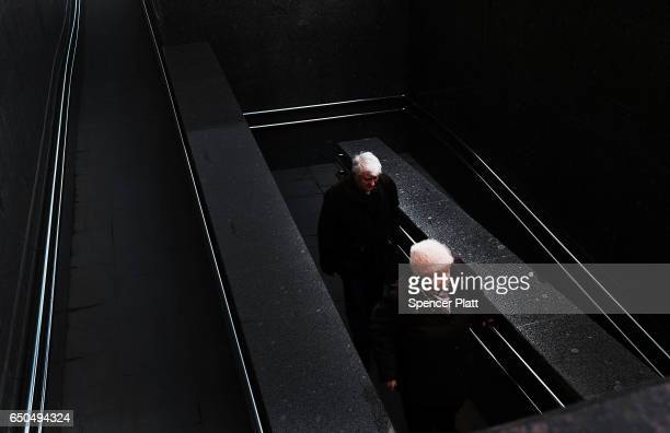 An elderly couple exit a metro station in Moscow on March 9 2017 in Moscow Russia Relations between the United States and Russia are at their lowest...