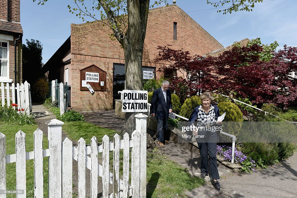 An elderly couple leave a polling station in Chipping Barnet, North London on May 5th 2015 in London, United Kingdom. A large number of people have been unable to vote Chipping Barnet, North London due to registration problems at polling stations across the borough. Today, dubbed 'Super Thursday', sees the British public vote in countrywide elections to choose members for the Scottish Parliament, the Welsh Assembly, the Northern Ireland Assembly, Local Councils, a new London Mayor and Police and Crime Commissioners. There are around 45 million registered voters in the UK and polling stations open from 7am until 10pm.
