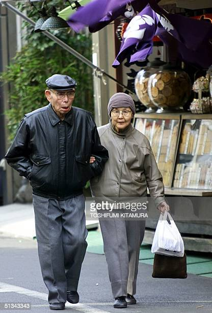 An elderly couple walks on a street in downtown Tokyo 09 February 2000 A care company Goodwill is positioning itself for what could be a golden...