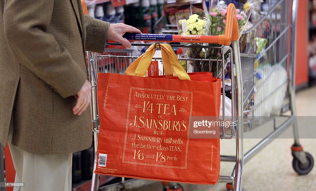 An elderly customer pushes a shopping cart through a Sainsbury's supermarket store, operated by J Sainsbury Plc, in Godalming, U.K., on Thursday, May 2, 2013. J Sainsbury Plc, the U.K.'s third-largest supermarket chain, will report full year results on May 8. Photographer: Chris Ratcliffe/Bloomberg via Getty Images