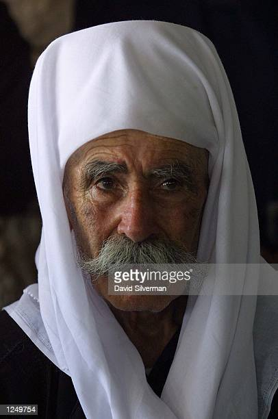An elderly Druze man stands tearyeyed during the funeral of SgtMajor Roni Ghanem August 5 2002 in the northern Israeli Druze village of Maghar The...
