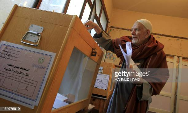 An elderly Egyptian man casts his vote at a polling station in the Manial neighbourhood of Cairo on November 28 2011 Egyptians began voting in the...