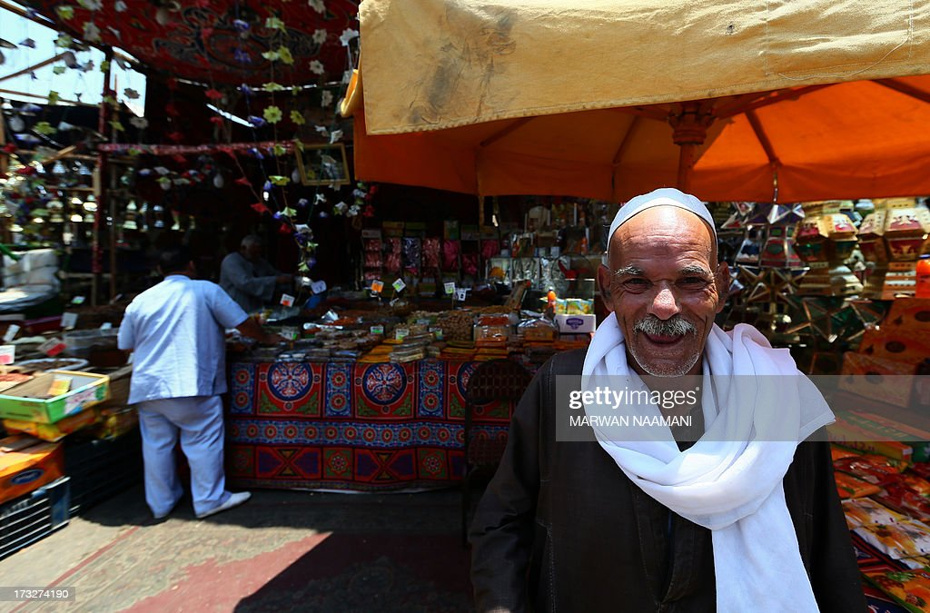 An elderly Egyptian man stands in front of a shop selling traditional Ramadan lanterns in the working-class Saida Zeinab district in Cairo on the second day of the Muslim holy fasting month of Ramadan July 11, 2013. Many Egyptians are marking Ramadan, where Muslims abstain from eating and drinking from dawn to dusk, as uncertainty riddles the country amid soaring tension following last weeks' toppling of Islamist president Mohamed Morsi. AFP PHOTO/MARWAN NAAMANI