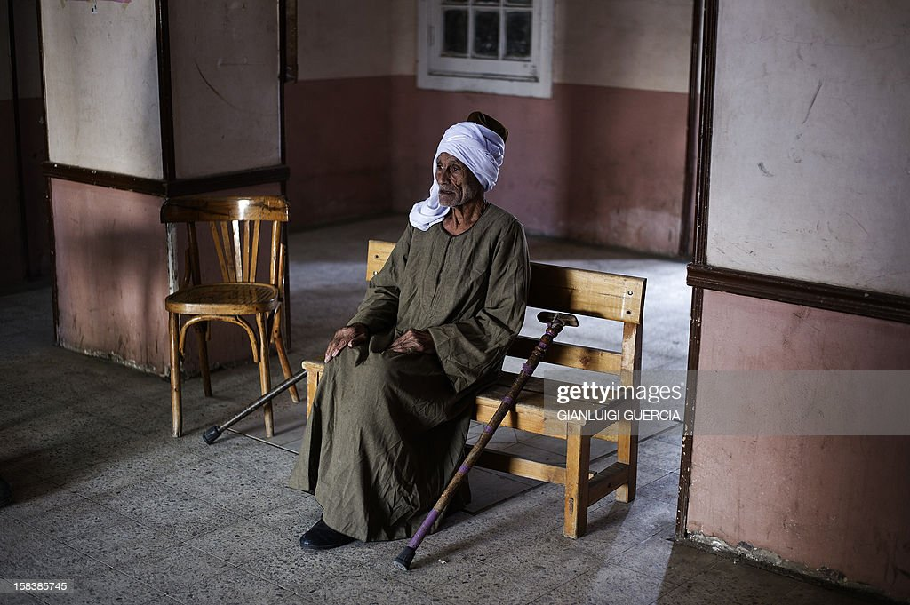 An elderly Egyptian man waits on a bench before casting his vote at a polling station in President Mohamed Morsi's hometown Zagazig in the Nile Delta on a new constitution supported by the ruling Islamists but bitterly contested by a secular-leaning opposition on December 15, 2012. Morsi's determined backing of the charter triggered the power struggle with the opposition, which is supported by judges who accuse the Islamists of overreaching.
