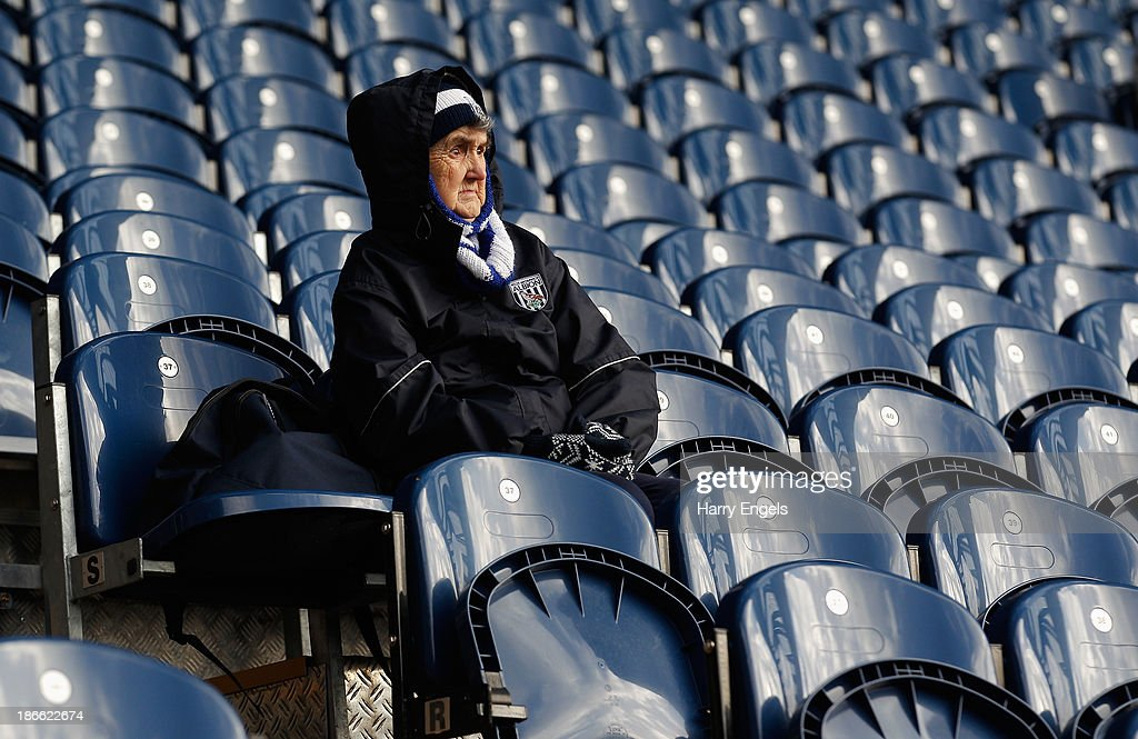An elderly fan soaks up the atmosphere prior to the Barclays Premier League match between West Bromwich Albion and Crystal Palace at The Hawthorns on November 2, 2013 in West Bromwich, England.