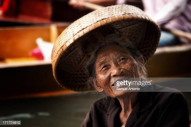 CONTENT] An elderly female Thai vendor at the Damnoen Saduak Floating Market outside of Bangkok Thailand Damnoen Saduak is a district in the province...
