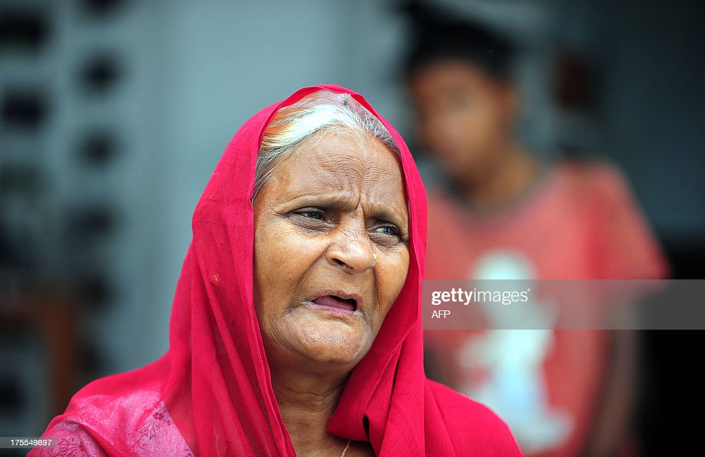 An elderly Indian flood-affected woman rests at a local shelter in Allahabad on August 4, 2013. The monsoon, which covers the subcontinent from June to September and usually brings flooding, accounts for about 80 percent of India's annual rainfall. AFP PHOTO/ SANJAY KANOJIA