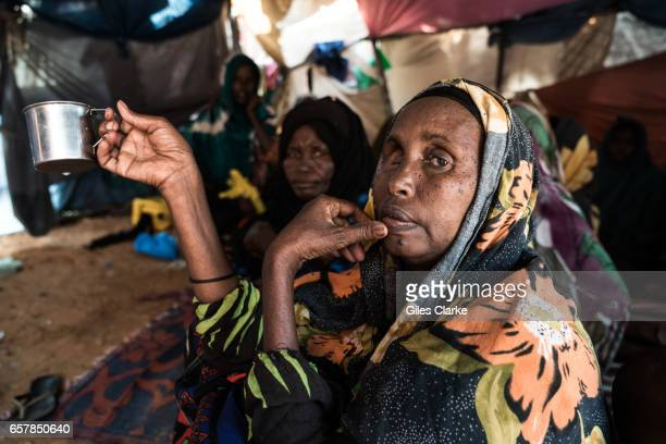 An elderly Internally Displaced Woman sits in a tent in a camp in central Mogadishu Somalia is in the grip of an intense drought induced by...