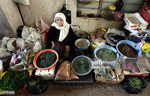 An elderly Iraqi Kurdish woman sells food in Dahuk bazaar on November 6 2007 in Dauhk city situated close to the Iraqi/Turkish border about 300 miles...