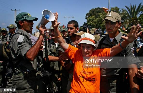 An elderly Israeli settler attempts to bloc border police officers on Tuesday August 16 2005 in the Jewish settlement of Neve Dekalim in the Gush...