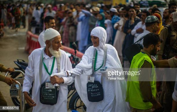 An elderly Kashmiri Muslim couple prepare to depart for the annual Hajj pilgrimage to Mecca on July 26 2017 in Srinagar the summer capital of Indian...