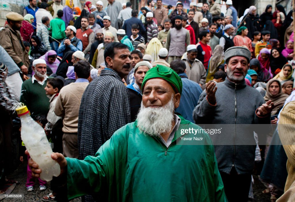 An elderly Kashmiri Muslim sprinkles rose water on the Muslim devotes at the shrine of Khaniqahi mullah during a festival on October 23, 2012 in Srinagar, the summer capital of Indian administered Kashmir, India. Thousands of Muslims thronged to the shrine of Mir Syed Ali Hamadan to commemorate the anniversary of the death of the Sufi saint, Hamadan. He is believed to be responsible for the spread of Islam in Kashmir. The shrine gains a special significance on 6th of Zilhaj (last month of Muslim calendar), the death anniversary of Mir Syed Ali Hamadan. On this day, devotees visit the shrine in large numbers to pay a tribute to saint Hamadan.