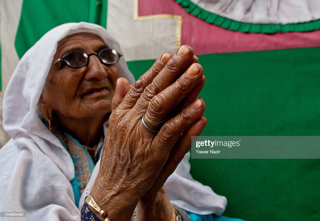 An elderly Kashmiri Muslim woman prays at the shrine of Khaniqahi mullah during a festival on October 23, 2012 in Srinagar, the summer capital of Indian administered Kashmir, India. Thousands of Muslims thronged to the shrine of Mir Syed Ali Hamadan to commemorate the anniversary of the death of the Sufi saint, Hamadan. He is believed to be responsible for the spread of Islam in Kashmir. The shrine gains a special significance on 6th of Zilhaj (last month of Muslim calendar), the death anniversary of Mir Syed Ali Hamadan. On this day, devotees visit the shrine in large numbers to pay a tribute to saint Hamadan.