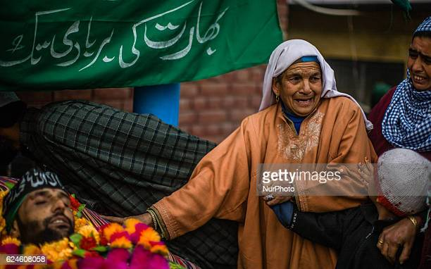 An elderly Kashmiri Muslim woman topuches the body of Rayees Ahmad a militant who was killed in a gun battle with the Indian government forces pecks...