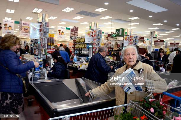 An elderly lady at the checkout counter as Italian supermarket chain Esselunga opens its first store in Rome in Via Palmiro Togliatti on April 5 2017...