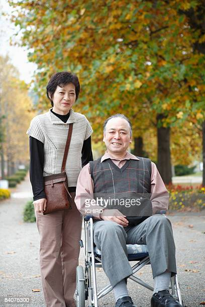 An elderly man and his wife.