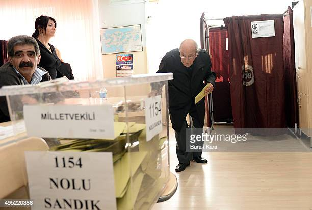 An elderly man casts his vote at a polling station during a general election on November 1 in Ankara Turkey Polls have opened in Turkey's second...