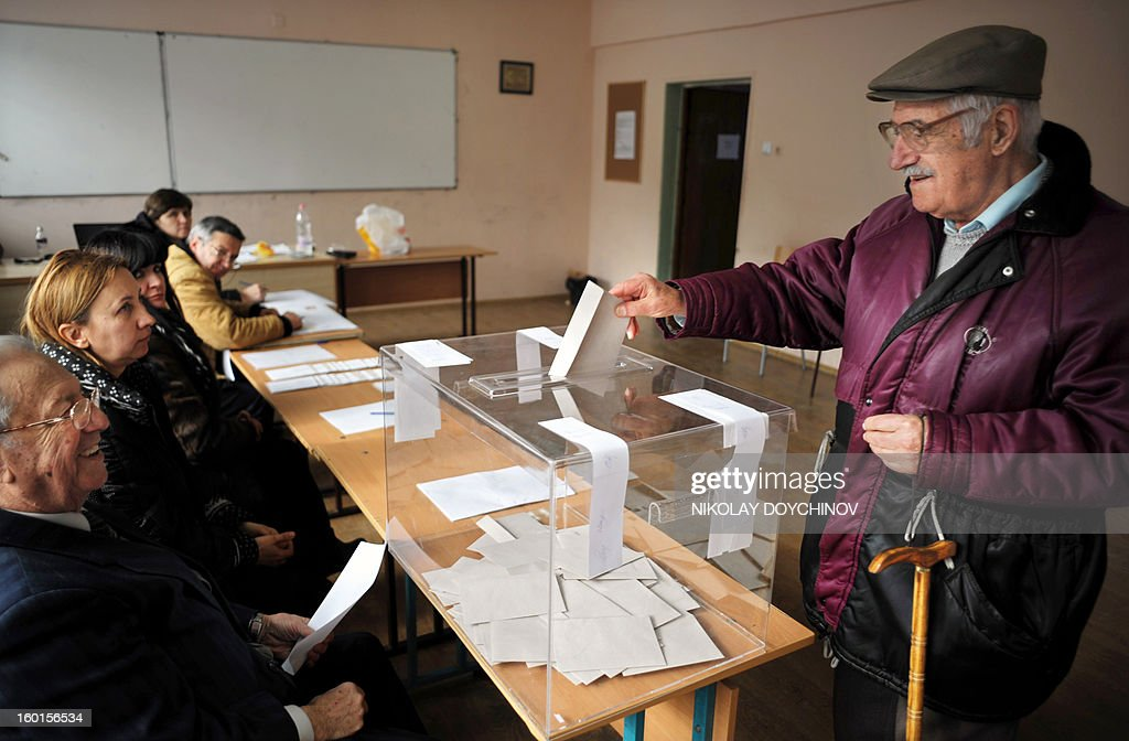 An elderly man casts his vote in a polling station during the national referendum in Sofia on January 27, 2013. Bulgarians voted Sunday on whether to revive plans ditched by the government to construct a second nuclear power plant, in the EU member's first referendum since communism. The referendum asks 6.9 million eligible voters: 'Should Bulgaria develop nuclear energy by constructing a new nuclear power plant ?'. AFP PHOTO / NIKOLAY DOYCHINOV