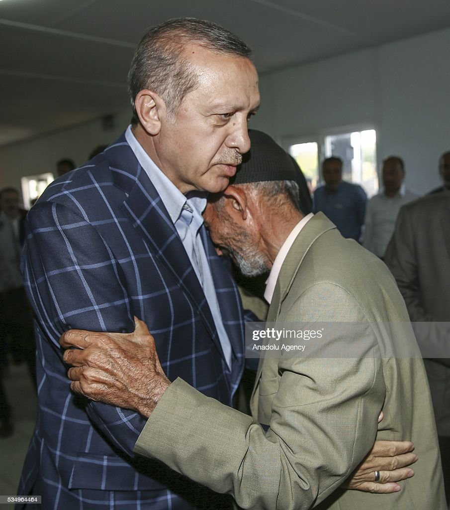 An elderly man hugs Turkish President Recep Tayyip Erdogan (L) during Erdogan's condolence visit to relatives of the PKK's terrorist attack victims in Tanisik village of Diyarbakir Province of Turkey on May 28, 2016. PKK killed 16 people and injured 23 earlier this month with a bomb-laden truck attack in Durumlu village of Diyarbakir. PKK is recognized as a terrorist organization by several states and organizations, including the North Atlantic Treaty Organisation (NATO) , European Union (EU) and USA and several other countries around the world. PKK has been staged varied terrorist attacks on civilians over 30 years in Turkey and other countries.