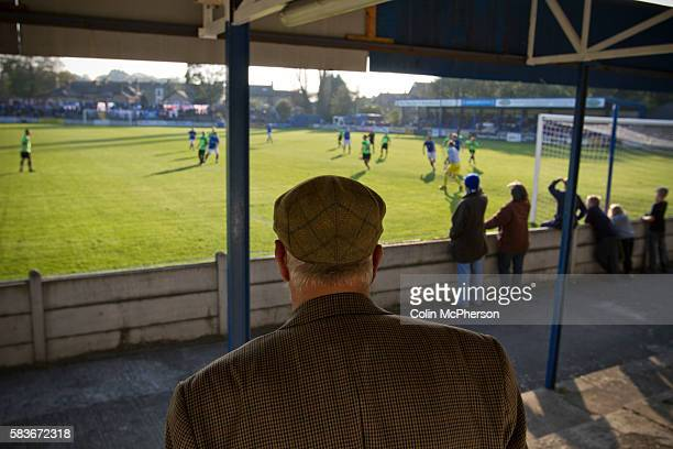 An elderly man in a flat cap watching the action from the terraces behind the goal during the second half as Lancaster City play against FC Halifax...