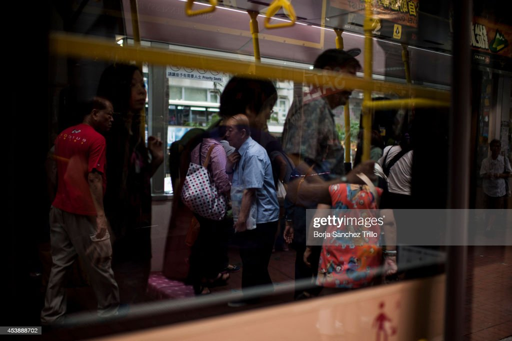 An elderly man is reflected through a bus window on August 20, 2014 in Hong Kong, Hong Kong. A government-commissioned study headed by University of Hong Kong academic Nelson Chow Wing-sun proposed to fund HK $3,000 a month pension for every Hongkonger over 65, rich or poor, without a means test. The pension should be funded partly by contributions ranging from 1 to 2.5 per cent of employees' salaries, paid by employers and workers. One in three old people in Hong Kong lives below estimated poverty line some of them struggling to make a living collecting cardboard boxes and plastic bottles on the street.