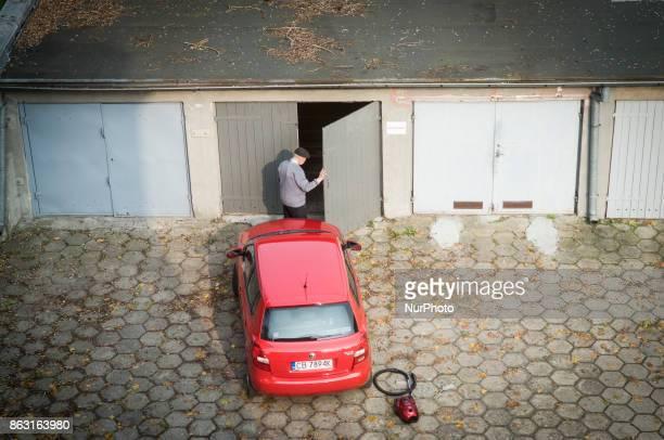 An elderly man is seen opening his garage in Bydgoszcz Poland on 19 October 2017