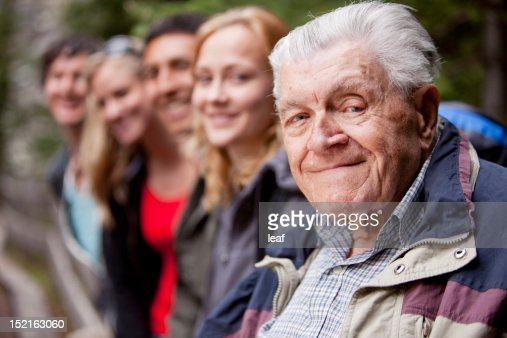 An elderly man looking into the camera : Stock Photo